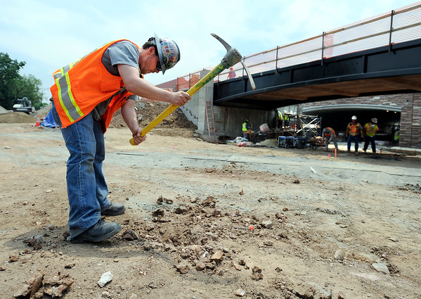 "Jim Colbeck digs a hole for a surveying point on Monday, July 2, while working on the underpass at Broadway and Euclid Street in Boulder. For a video about the construction site and projected completion go to  <a href=""http://www.dailycamera.com"">http://www.dailycamera.com</a><br /> Jeremy Papasso/ Camera"