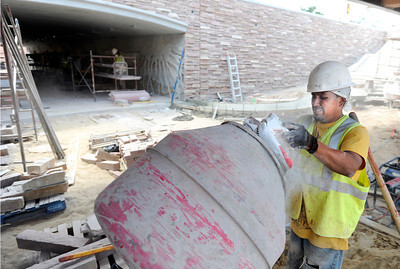 Javier Valterra, of Concrete Works of Colorado, mixes concrete on Monday, July 2, while working on the underpass at Broadway and Euclid Street in Boulder. For a video about the construction site and projected completion go to www.dailycamera.com Jeremy Papasso/ Camera
