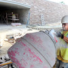 "Javier Valterra, of Concrete Works of Colorado, mixes concrete on Monday, July 2, while working on the underpass at Broadway and Euclid Street in Boulder. For a video about the construction site and projected completion go to  <a href=""http://www.dailycamera.com"">http://www.dailycamera.com</a><br /> Jeremy Papasso/ Camera"