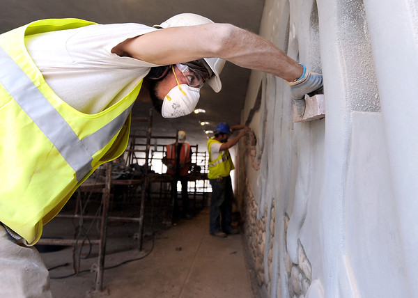 """Peter Maffey, of Stonescapes works to fit stone into the underpass design, on Monday, July 2, while working on the underpass at Broadway and Euclid Street in Boulder. For a video about the construction site and projected completion go to  <a href=""""http://www.dailycamera.com"""">http://www.dailycamera.com</a><br /> Jeremy Papasso/ Camera"""