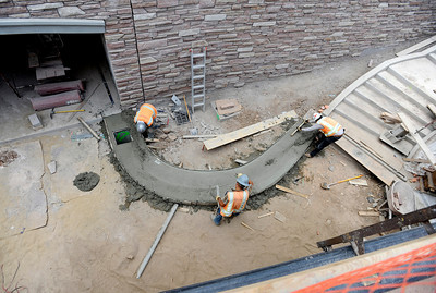 Concrete Works of Colorado employees float the concrete on Monday, July 2, while working on the underpass at Broadway and Euclid Street in Boulder. For a video about the construction site and projected completion go to www.dailycamera.com Jeremy Papasso/ Camera