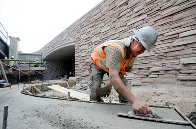 Eleazar Martinez, of Concrete Works of Colorado, floats concrete on Monday, July 2, while working on the underpass at Broadway and Euclid Street in Boulder. For a video about the construction site and projected completion go to www.dailycamera.com Jeremy Papasso/ Camera