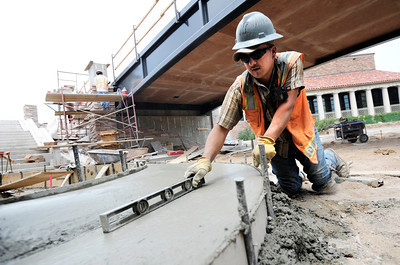 Omar Sanchez, of Concrete Works of Colorado, makes sure the concrete is level on Monday, July 2, while working on the underpass at Broadway and Euclid Street in Boulder. For a video about the construction site and projected completion go to www.dailycamera.com Jeremy Papasso/ Camera