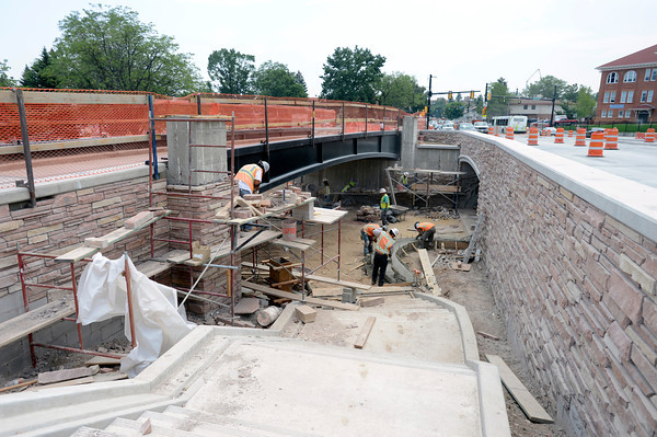"""Construction crews pour concrete and lay stone on the wall on Monday, July 2, while working on the underpass at Broadway and Euclid Street in Boulder. For a video about the construction site and projected completion go to  <a href=""""http://www.dailycamera.com"""">http://www.dailycamera.com</a><br /> Jeremy Papasso/ Camera"""