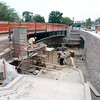 "Construction crews pour concrete and lay stone on the wall on Monday, July 2, while working on the underpass at Broadway and Euclid Street in Boulder. For a video about the construction site and projected completion go to  <a href=""http://www.dailycamera.com"">http://www.dailycamera.com</a><br /> Jeremy Papasso/ Camera"