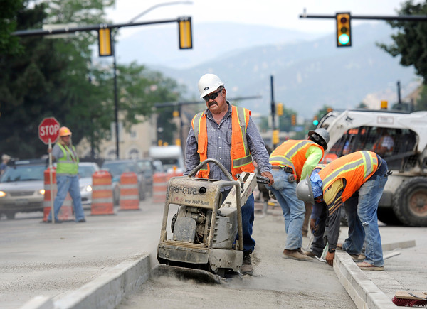 """Mario Chavez, of Concrete Works of Colorado, uses a compactor to to press the dirt before pouring concrete on Monday, July 2, while working near the intersection of Broadway and Euclid Street in Boulder. For a video about the construction site and projected completion go to  <a href=""""http://www.dailycamera.com"""">http://www.dailycamera.com</a><br /> Jeremy Papasso/ Camera"""