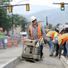 "Mario Chavez, of Concrete Works of Colorado, uses a compactor to to press the dirt before pouring concrete on Monday, July 2, while working near the intersection of Broadway and Euclid Street in Boulder. For a video about the construction site and projected completion go to  <a href=""http://www.dailycamera.com"">http://www.dailycamera.com</a><br /> Jeremy Papasso/ Camera"