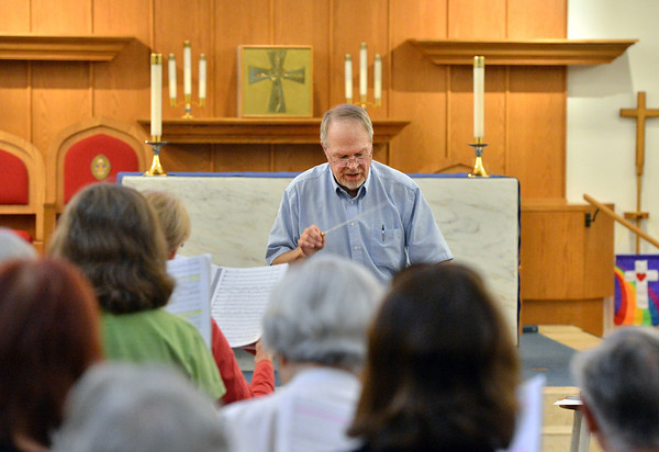 Ron Williams directs  the Broomfield Choral Festival Chorus during rehearsal of the Schubert Mass #6 in E flat at Holy Comforter Church.<br />  August 16, 2012<br /> staff photo/ David R. Jennings