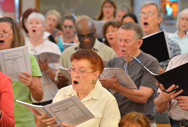 Sue Christensen, center, sings with the members of the Broomfield Choral Festival Chorus during rehearsal of the Schubert Mass #6 in E flat at Holy Comforter Church.<br />  August 16, 2012<br /> staff photo/ David R. Jennings