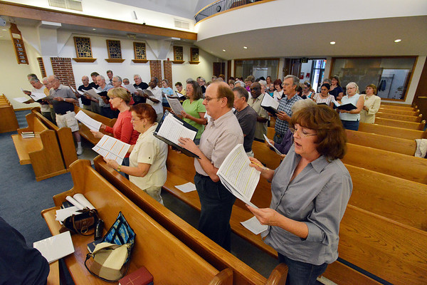 Members of the Broomfield Choral Festival Chorus rehearse the Schubert Mass #6 in E flat at Holy Comforter Church for an upcoming performance.<br />  August 16, 2012<br /> staff photo/ David R. Jennings