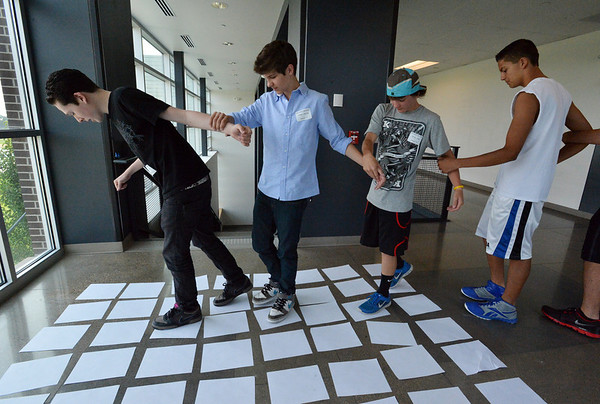 Freshman Max Antoine, left, leads classmates in his group through a puzzle maze during the Blue Crew freshman orientation at Broomfield High School on Wednesday. <br />  August 15, 2012<br /> staff photo/ David R. Jennings