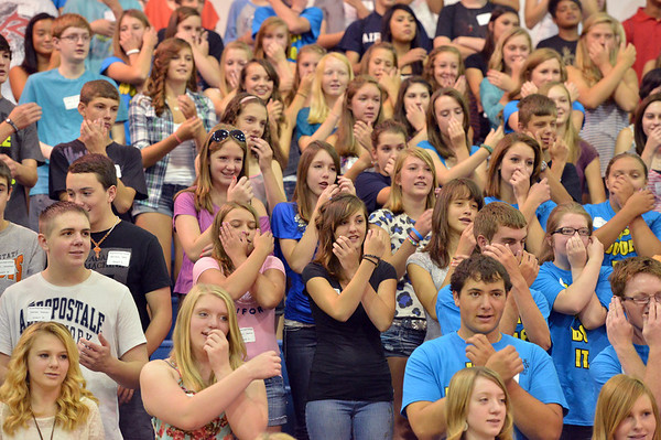 Freshmen at the Blue Crew freshman orientation try to follow along the gestures to a song at Broomfield High School on Wednesday. <br />  August 15, 2012<br /> staff photo/ David R. Jennings