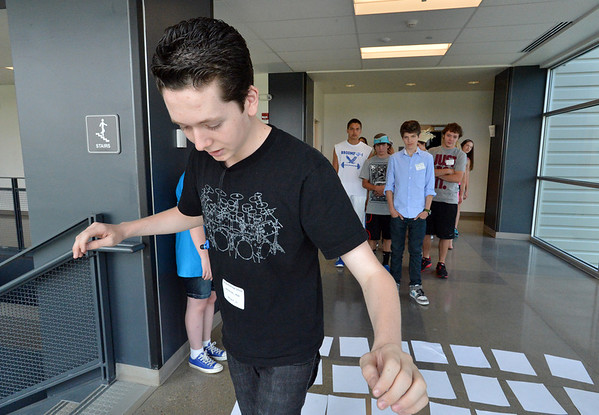 Freshman Max Antoine works his way through a puzzle maze during the Blue Crew freshman orientation at Broomfield High School on Wednesday. <br />  August 15, 2012<br /> staff photo/ David R. Jennings