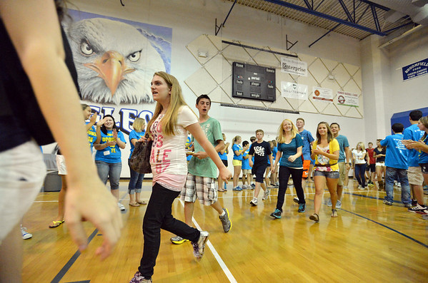 Members of the class of 2016 enter the Eagle Gym for the Blue Crew freshman orientation cheered by teachers and upperclassmen  at Broomfield High School on Wednesday. <br />  August 15, 2012<br /> staff photo/ David R. Jennings