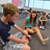 Freshman Isabella Marshal, right, is surprised when classmate Connor Plooy, left, guessed the cereal she eats for breakfast during the Blue Crew freshman orientation at Broomfield High School on Wednesday. <br />  August 15, 2012<br /> staff photo/ David R. Jennings