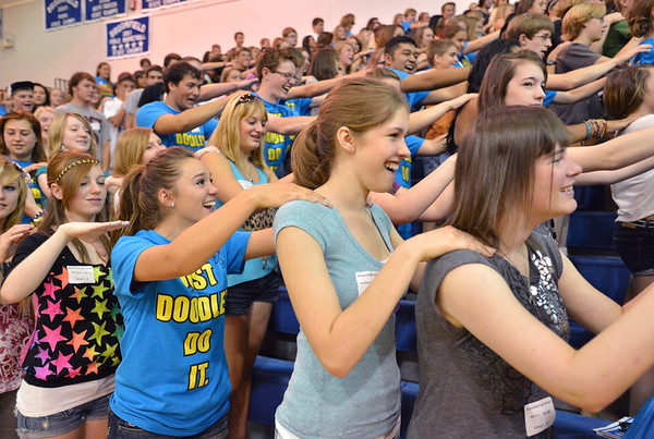 Freshmen Sarah Monte, right, Elizabeth Hackbarth,  Blue Crew leader Matilda Whitmore and Kelly Ghiazza massage each other's backs during freshman orientation at Broomfield High School on Wednesday. <br />  August 15, 2012<br /> staff photo/ David R. Jennings