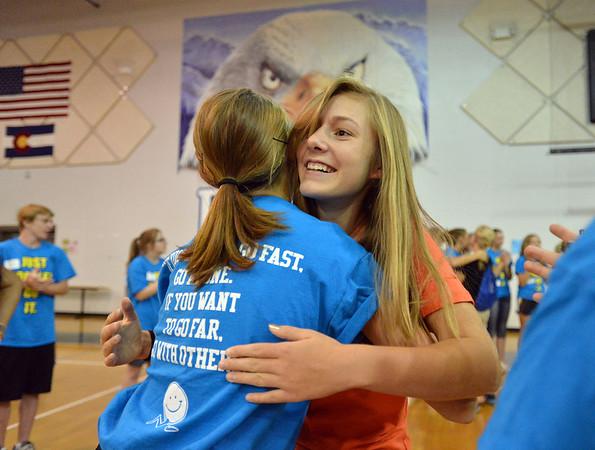Freshman Claire Schuringa, right, hugs upperclassman Amanda  Campbell during the Blue Crew freshman orientation at Broomfield High School on Wednesday. <br />  August 15, 2012<br /> staff photo/ David R. Jennings