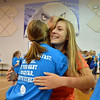 Freshman Claire Schuringa, right, hugs upperclassman Amanda  Campbell during the Blue Crew freshman orientation at Broomfield High School on Wednesday. <br />  August 15, 2012<br /> staff photo/ David R. Jennings