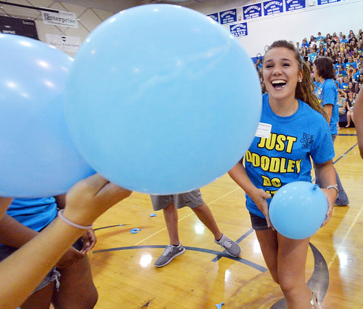 Blue crew leader Matilda Whitemore laughs during the balloon popping contest at the Blue Crew freshman orientation at Broomfield High School on Wednesday. <br />  August 15, 2012<br /> staff photo/ David R. Jennings