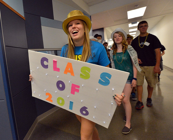 Blue Crew leader Annie Bingham carries a sign while leading her group of freshmen on a tour of the school during the Blue Crew freshman orientation at Broomfield High School on Wednesday. <br />  August 15, 2012<br /> staff photo/ David R. Jennings