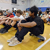 Pukar Sharma sits on his skateboard during the Blue Crew freshman orientation at Broomfield High School on Wednesday. <br />  August 15, 2012<br /> staff photo/ David R. Jennings