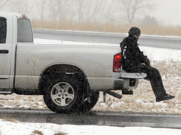 A Broomfield Police SWAT team member is transported back to the staging area after they arrested a man barricaded in a motor home on Mountain View St. on Thursday.<br /> February 3, 2011<br /> staff photo/David R. Jennings