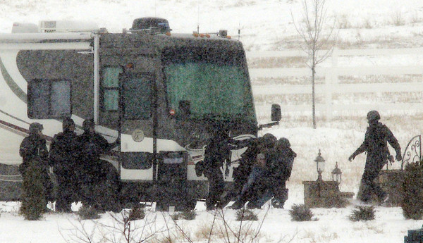 Broomfield Police SWAT team members arrest a man barricaded in a motor home on Moutain View St.  on Thursday.<br /> February 3, 2011<br /> staff photo/David R. Jennings