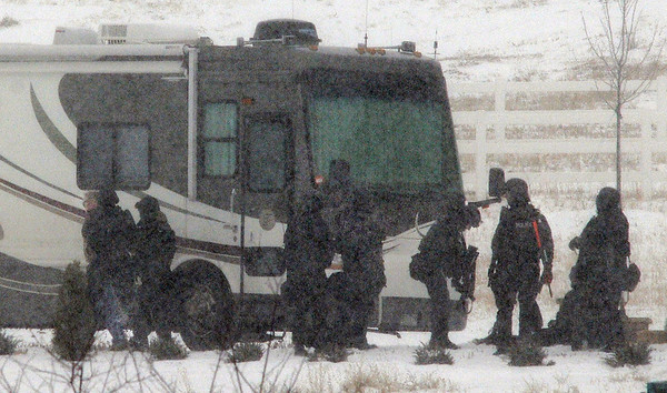 Broomfield Police SWAT team members arrest a man bariccade in a motor home on Mountain View St. on Thursday.<br /> February 3, 2011<br /> staff photo/David R. Jennings