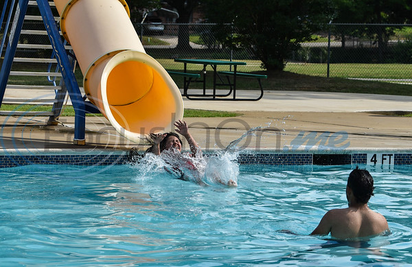A teenage girl splashes into the Buckner Park pool in Jacksonville on Tuesday, June 16. The City's pool will require special healthcare precautions and rules for the summer due to the coronavirus pandemic.
