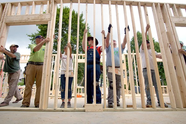 BEN GARVER — THE BERKSHIRE EAGLE<br /> Members of the Barnwell First Baptist Construction Ministry raise a wall for the Open Door Church in Lee.  The group traveled from South Carolina to help build the Church out of a gymnasium on the former Kolbourne School Property. Tuesday, July 11, 2017.