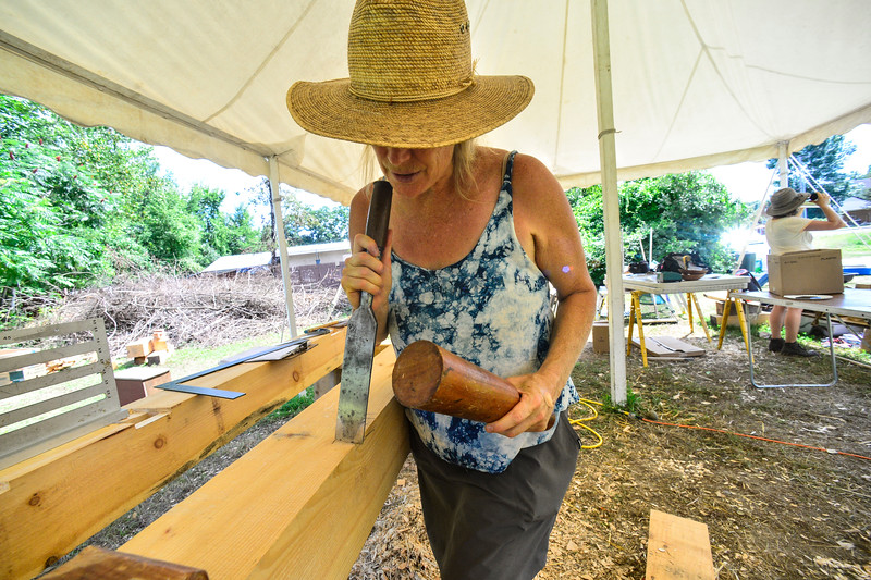 KRISTOPHER RADDER — BRATTLEBORO REFORMER<br /> People finish working on a timber frame during a 10-day place-based building series hosted at Terra Collaborative, in Putney, Vt., on Monday, July 29, 2019.