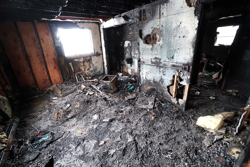 BEN GARVER — THE BERKSHIRE EAGLE<br /> The duplex at 125-127 Burke Ave was gutted by fire Sunday night, destroying all the occupants possessions and injuring three occupants and two firefighters. Monday March 5, 2016.