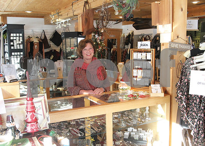 "Spencer Tulis/Finger Lakes Times Carol Steppe owns ""the Little Red Barn,"" the site is home to Keuka Inspirations on Route 54A between Penn Yan and Branchport, the Bluff Point area in the town of Jerusalem. It is a gift shop features many items that draw attention to nearby Keuka Lake."