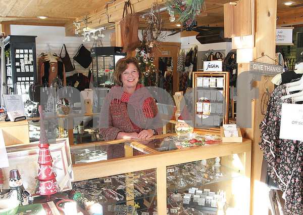 """Spencer Tulis/Finger Lakes Times Carol Steppe owns """"the Little Red Barn,"""" the site is home to Keuka Inspirations on Route 54A between Penn Yan and Branchport, the Bluff Point area in the town of Jerusalem. It is a gift shop features many items that draw attention to nearby Keuka Lake."""