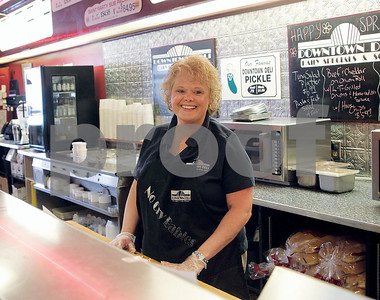 Spencer Tulis / Finger Lakes Times Owned and operated by Ann (picture) and Pat Sandroni, the Downtown Deli in Seneca Falls has served giant New York-style  sandwiches, subs, bagels, soups and salads to thousands since 1994.