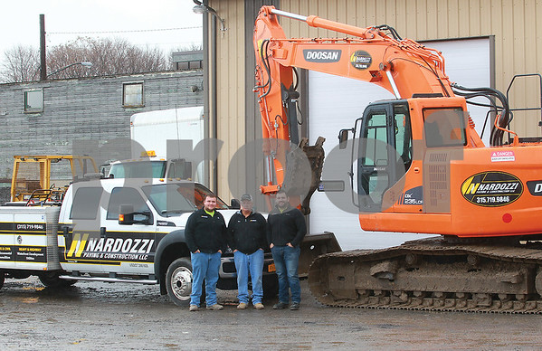 Spencer Tulis/Finger Lakes Times There are  three separate companies under the Nardozzi Companies umbrella: Nardozzi Paving and Construction, Finger Lakes Landscaping and Masonry and Nardozzi Holdings, a real estate development company. (l-r) Mike, Don and Jim Nardozzi