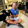 SPARKFUN2.JPG Nathan Seidle, CEO and Founder of Sparkfun with several his employees' dogs on the production floor of the company's Boulder offices on September 29, 2011.<br /> Photo by Paul Aiken / September 262011
