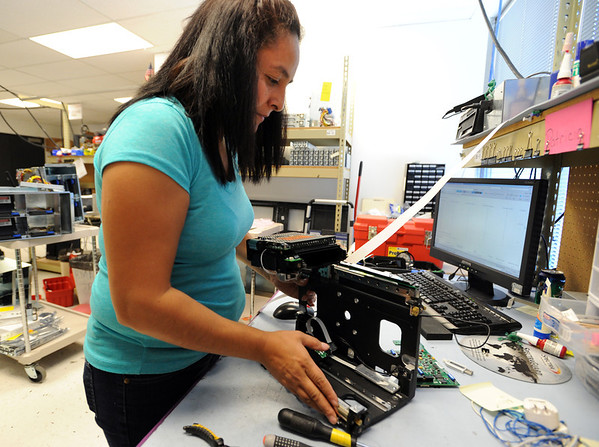 Spectra Logic Nathan Thompson20.JPG Patricia Vasquez, a technician at Spectra Logic, works on a component on Thursday.<br /> Nathan Thompson started his Spectra Logic storage business from his dorm room when he was a University of Colorado student.<br /> Cliff Grassmick / September 30, 2011