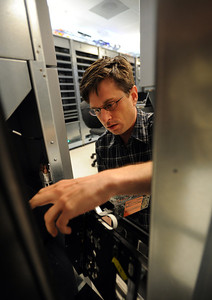 Spectra Logic Nathan Thompson4.JPG Daniel Zmolek, a software engineer at Spectra Logic, works on a component on Thursday. Nathan Thompson started his Spectra Logic storage business from his dorm room when he was a University of Colorado student. Cliff Grassmick / September 30, 2011