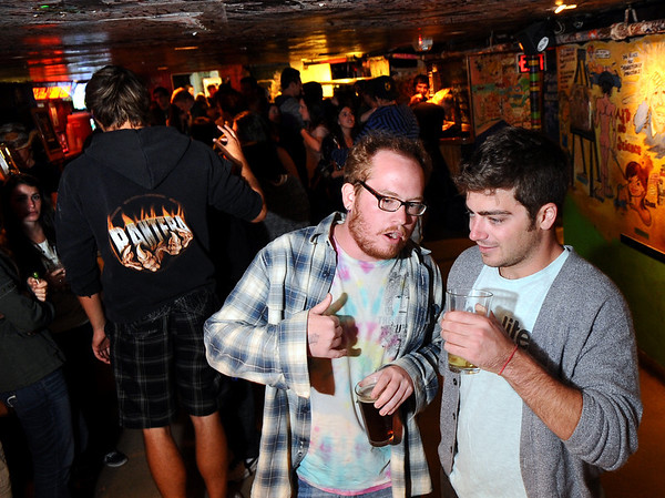Lokalite002.JPG Lokalite C.E.O and co-founder Zach Premer, of Boulder, right, talks with Matt Bovard, of Louisville, on Thursday, Oct. 6, during a Lokalite party at The Sink on University Hill in Boulder.<br /> Jeremy Papasso/ Camera
