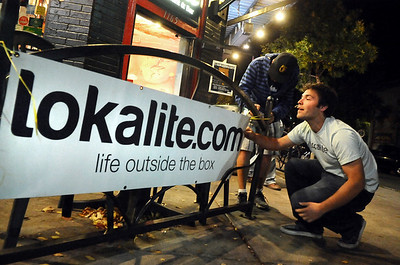 Lokalite001.JPG Lokalite co-founder Graham Christy, right, and Harrison Fast, of Boulder, work together to put up a Lokalite banner outside of The Sink on University Hill on Thursday, Oct. 6, during a Lokalite party. Jeremy Papasso/ Camera
