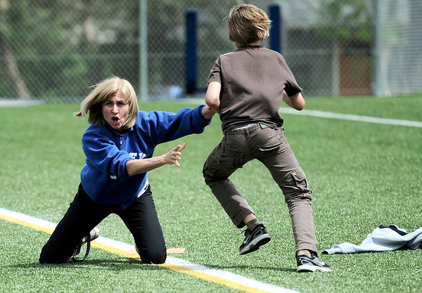"0526CASEY6.jpg Allison Boggs tries to keep Brono van der Beek (cq) off first base while playing a students vs teacher kickball game at Casey Middle School Boulder, Colorado May 26, 2011.  Thursday was the last day of school for Casey Middle School. CAMERA/Mark Leffingwell <br /> <br /> Watch video of the kickball game at  <a href=""http://www.dailycamera.com"">http://www.dailycamera.com</a>"