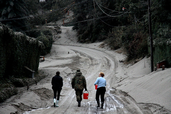 Argentina Chile Volcano(3).JPG A soldier helps Maria Monica Quintana, right, and her daughter Milagros Nazar Anchorena carry water to their home in La Angostura, southern Argentina, after the area was affected due to the eruption of the Chilean Puyehue-Cordon Caulle volcano Wednesday, June 8, 2011. The volcano erupted Saturday after remaining dormant for decades, causing the evacuation of about 3,500 people in the nearby area and carrying ash across the Andes to Argentina. (AP Photo/Alfredo Leiva)