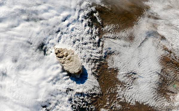 Chile Volcano.JPEG-032fc.JPG A photo released by NASA is a June 4, 2011, photo of Chile's Puyehue-Cordón Caulle Volcano was made by the MODI Aqua satellite shortly after the eruption began sahowing the brown plume rising above the clouds.  The eruption has forced thousands from their homes, grounded airline flights in southern Argentina and coated ski resorts with a gritty layer of dust instead of snow.  (AP Photo/NASA)