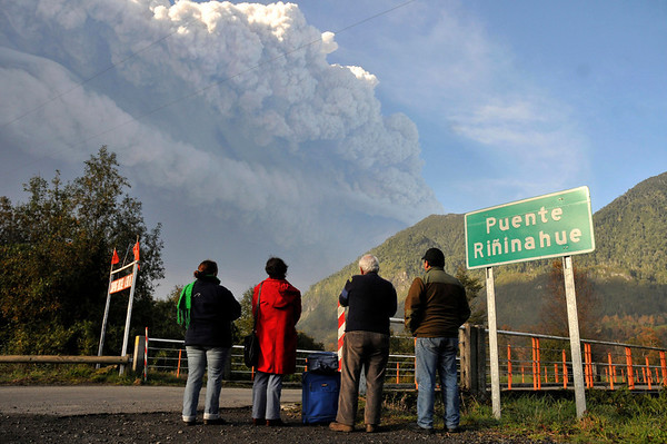 Chile Volcano.JPEG-0ee01.JPG Residents of Rininahue look at a plume of smoke and ash merging from the Puyehue-Cordon Caulle volcano in Rininahue near Lago Ranco, over 500 miles south of Santiago, Chile, Monday June 6, 2011. Authorities have evacuated about 3,500 people in the nearby area. The volcano was calm on Monday, two days after raining down ash and forcing thousands to flee, although the cloud of soot it had belched out still darkened skies as far away as Argentina. (AP Photo/Carlos Succo)
