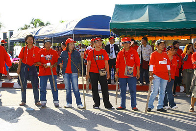 Red Shirt pro-government supporters gather at Chiang Mai airport.