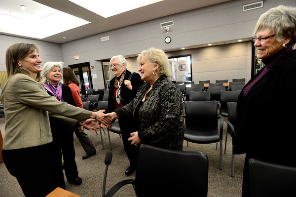 From left to right County Commissioners Elise Jones and Deb Gardner greet three of the four former female County Commissioners Maggi Markey, Jana Mendez and Josie Heath at the Boulder County Courthouse in Boulder.  Jones and Gardner were sworn in on Tuesday January 8, 2013. <br /> Photo by Paul Aiken / The Daily Camera / January 8, 2013