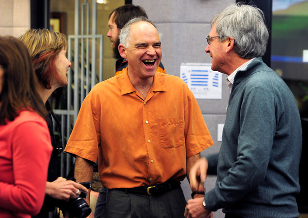 Former County Commissioner Will Toor, center, laughs with City Council members Suzanne Jones, and Macon Cowles at the Boulder County Courthouse in Boulder.  Toor was term-limited and replaced by Elise Jones in a ceremony Tuesday January 8, 2013<br /> Photo by Paul Aiken / The Daily Camera / January 8, 2013