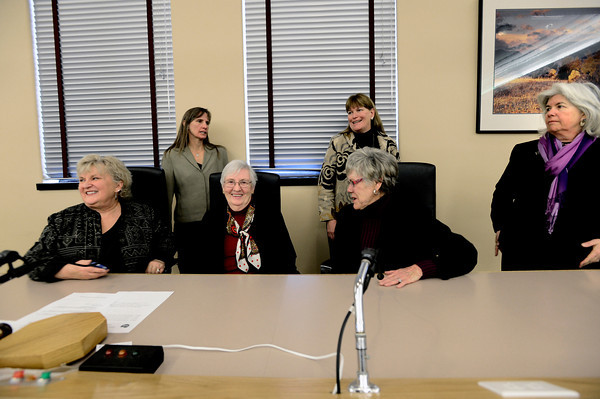 In back from left to right County Commissioners Elise Jones, Cindy Domenico and Deb Gardner greet three of the four former female County Commissioners Jana Mendez, Maggi Markey, and Josie Heath as they prepare for a group photo at the Boulder County Courthouse in Boulder.  Jones and Gardner were sworn in on Tuesday January 8, 2013. <br /> Photo by Paul Aiken / The Daily Camera / January 8, 2013