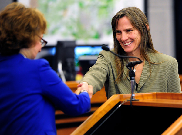 Elise Jones shakes Chief Boulder County District judge Roxanne Balin's hand at the Boulder County Courthouse in  Boulder after she was sworn in as a Boulder County Commissioner on Tuesday January 8, 2013<br /> Photo by Paul Aiken / The Daily Camera / January 8, 2013